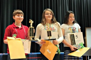Winners of the JCS Elementary Spelling Bee. Pictured, left, 3rd place winner, Jacob Ellis (Four Oaks Elementary); 1st place winner, Ariana Arbelaez (Cooper Elementary); and 2nd place winner Whitley McCoy (Princeton Elementary). ​