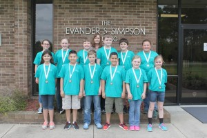 Meadow School Battle of the Books team members.From left,  front row,  Jada Barefoot, Jaleel Carranza, Elliot Butler, Jared Carranza, ReaganWilliford, and Lyda Boone. Middle row, Emma Stewart, Kaitlyn Giddens, Braden Raynor, Adam Miller, Preston Parker, and Anna Knowles. Back row,  BOB Coach Heather Sutton.