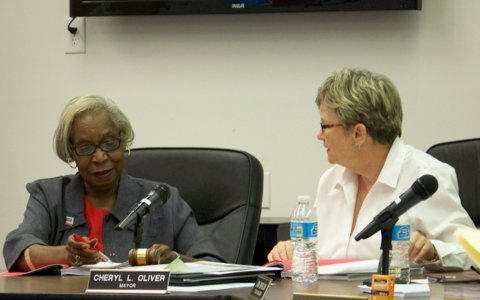 (Left to right) Selma town councilwoman Jacy Lacy discusses a resolution concerning Smithfield and Selma area schools with Mayor Cheryl Oliver prior to a 4-1 vote to approve the resolution Tuesday night. WTSB Photo