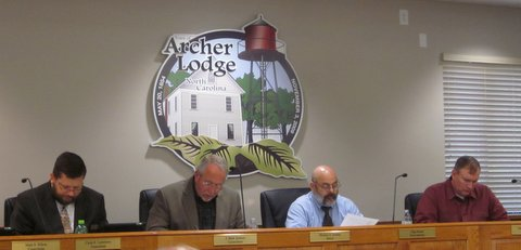 Caption:  Mayor Mike Gordon and council members review the proposed 2015-2016 budget