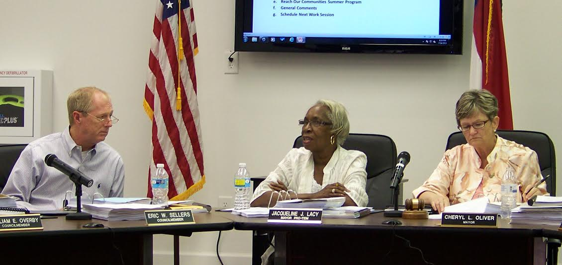 (Left) Councilman Eric Sellers and Mayor Cheryl Oliver (far right) listen to Councilman Jackie Lacy (center) discuss why Lacy voted for a 10 percent power rate reduction. Sellers and Oliver voted against the decrease. WTSB Photo