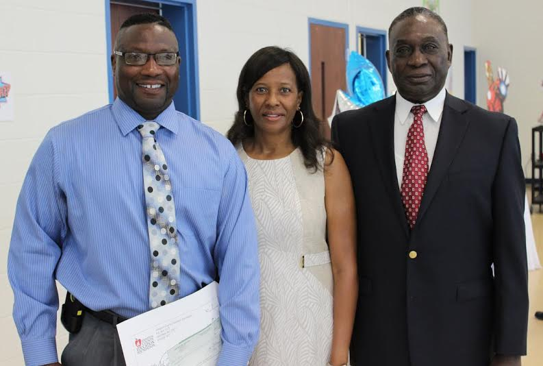 South Johnston High School's Tol Avery (left) is the 2015-2016 Assistant Principal of the Year for Johnston County Schools. Standing beside him (from left) are Bernita Nicolas and his father, Hubert Avery.