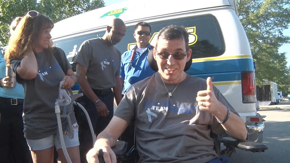 Jason Palmer gives a thumbs up to his supporters Saturday after raising $27,000 for the Johnston County EMS paramedic diagnosed with ALS.
