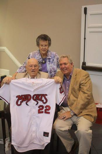 (Left to Right – Front) Bill Perry shows off a Carolina Mudcats jersey given to him by Mudcats owner Steve Bryant, during a surprise 90th birthday party on Sunday.  Perry and his wife, Vertie (center) have been married for 64 years.