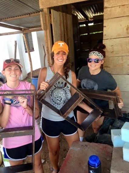 Selma Elementary teachers Katie Strickland, Dani Yarborough, and Heidi Meyer help make bricks for women housing in Granada, Nicaragua on July 20.