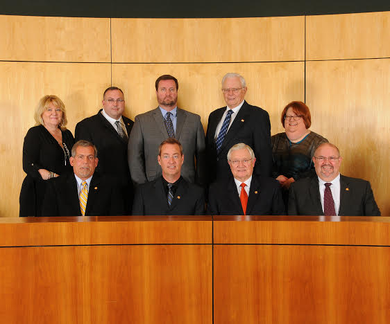 From left, back row: Town Clerk Kimberly Moffett; Councilman Jason Thompson; Town Manager Steve Biggs; Councilman Art Holder; Deputy Town Manager Nancy Medlin. Front Row: Councilman Bob Satterfield; Mayor Jody McLeod; Mayor Pro Tem Michael Grannis; Councilman Butch Lawter.