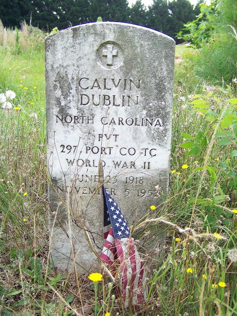 A tattered American flag is overrun with weeds at the unkempt grave of World War II Veteran Calvin Dublin who was buried in 1952 in what is now an abandoned cemetery in Selma. An estimated 140 graves are located on the acre tract of land. About 60 of the graves are marked only with crosses bearing no names. Another 30 graves markers have been vandalized. Many others are leaning and in need of repair. JoCoReport.com Photo
