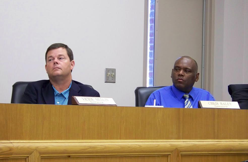 (Left to right) Four Oaks town commissioners Vic Medlin and Chris Haley listen to comments during a public hearing on the 2016-17 fiscal year budget Monday night. After the hearing, the board voted unanimously to raise the property tax rate from 38 to 42 cents. JoCoReport.com Photo