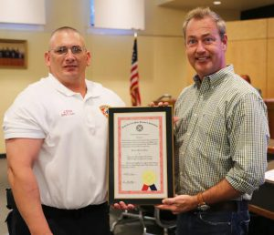 Clayton Deputy Fire Chief Jason Dean is recognized by Clayton Mayor Jody McLeod and the Clayton Town Council for his achievement of receiving the Firefighter's Advanced Professional Certificate.
