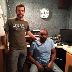Rev. Jesse Lee Peterson (seated) and his producer James Hake complete their live 3 hours radio show in California from a studio at AM-1270 WMPM in Smithfield on Thursday.