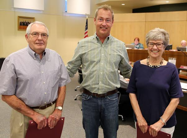 From left to right: Hubert Schmidt, Mayor McLeod, and Judith Schmidt
