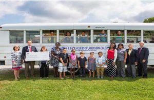 (Inside Bus Left to Right) Jada Edwards, Trinity Wesley, Makayla Harrington, Dacis Everette, Lyric Whitley (Outside Bus) Rosemary Wyche, Bruce McKay (Both are with Atlantic Coast Pipeline), Tammy Mitchell, BGCJC Board President, Mamie Moore (Club Director of B&GC), Owen Sanchez, Aniya Williams, Jason Flores, Miley Castro, Josue Gonzalez, and Gabbi Haire, Club Staff, Tammy Thurman with Piedmont Natural Gas, Ted Godwin, Johnston County Commissioner and Marty Clayton – Duke Progress Energy