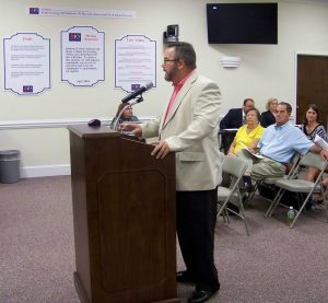 Smithfield Selma High School Booster President Jay Moore addresses the Johnston County Board of Education at their Aug. 9th meeting.  Moore wants a multi-use facility built on the SSS campus for the students and the community to replace the former Field House. JoCoReport.com Photo