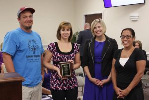 McGee's Crossroads Middle receives a plaque for raising the most money out of all of the middle schools in the county for the American Heart Association last year. Pictured are McGee's Middle PE teachers Jamie Jarman and Deborah Reece, Principal Dorlisa Johnston-Cowart, and American Heart Association Youth Market Associate Lori McCain.