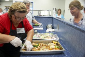 Rodica Ban from Cleveland Elementary prepares Sweet Thai Chicken at the North Carolina K-12 Culinary Institute held at Cleveland High.