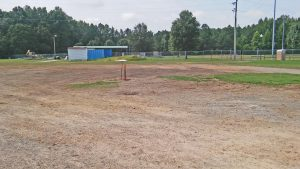 An empty space is all that remains after the Field House at Smithfield Selma High School was torn down last month. The school-owned building was removed without any state or county permits.  A state health official tells WTSB News a decision has not been made if a fine will be levied in the case. JoCoReport.com Photo