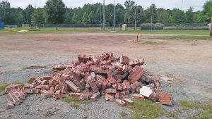 A few bricks are all that remains of the Field House at Smithfield Selma High School.  On Monday, Smithfield Planning Director Paul Embler filed a complaint with the Johnston County Inspections Office saying neither the school system nor sub-contractor who removed the building obtained a demolition permit for the project. JoCoReport.com Photo